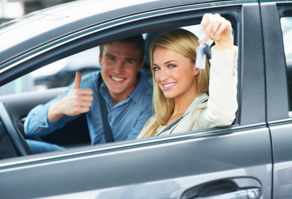 Millennial couple in new car they just purchased - Redline Affinity Group auto dealership marketing